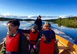 Riverboat cruise to reindeer farm